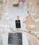 Wedding reception Barbie Blank and Sheldon Souray mini tequila bottle escort cards matching menu