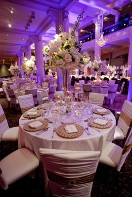Purple wedding lighting with white and gold table decorations
