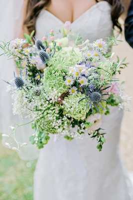 bride natural wildflower bouquet daisies thistles greenery pink blue english british wedding
