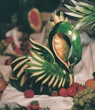 Swan-shaped carved watermelon on fruit table