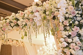blush and ivory roses and white orchids on floral chuppah