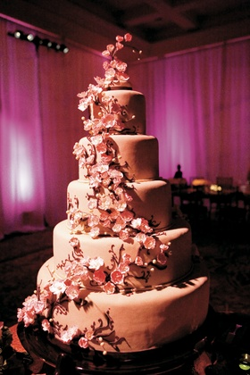 cake decorated with edible pink cherry blossoms