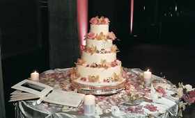 Cake with ivory frosting and colorful flowers