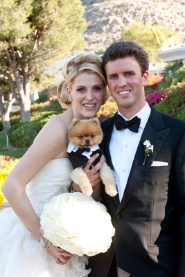 Bride and groom with dog on wedding day
