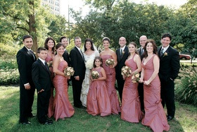 Bride and groom with groomsmen and bridesmaids in ruched dresses