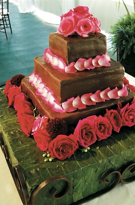 Three layer cake with rose and dahlia decoration