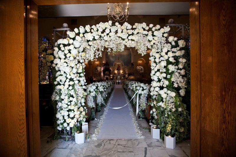 Ceremony dcor photos all white ceremony entrance inside weddings floral embellished arch and church pews junglespirit Choice Image