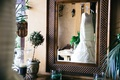 view of mermaid gown through mirror