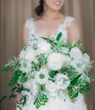 bride holding white flower greenery bouquet loose freshly picked garden rose roses ferns
