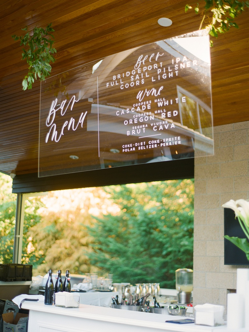backyard wedding reception with suspended acrylic sheet as bar menu