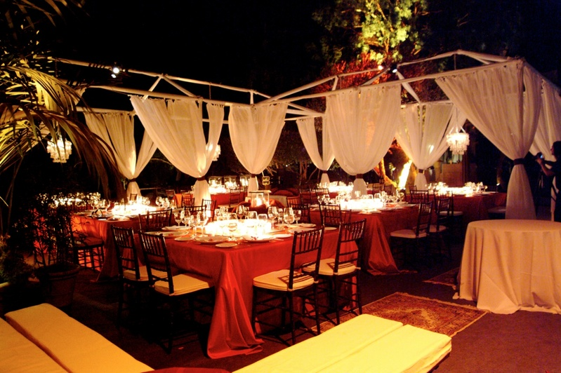 Reception dcor photos outdoor reception space persian rugs scarlet tablecloths on tables and billowing drapery junglespirit Gallery