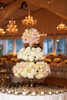 escort card setting table, three-tiered floral arrangement