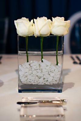 White single roses in rectangular vase