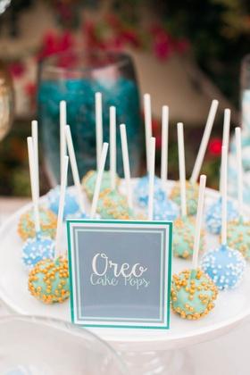 gourmet oreo cake pops in blue, green, with sprinkles for dessert bar