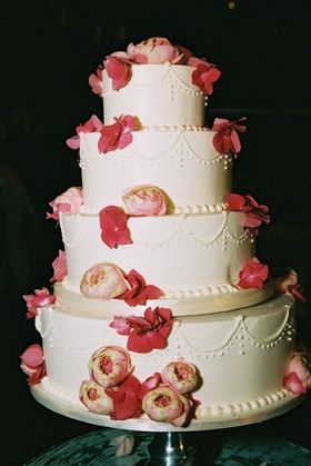 Four layer cake with peonies and roses