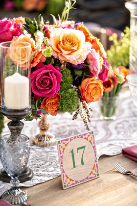 bohemian wedding reception wood table with table number pink orange green purple lace runner