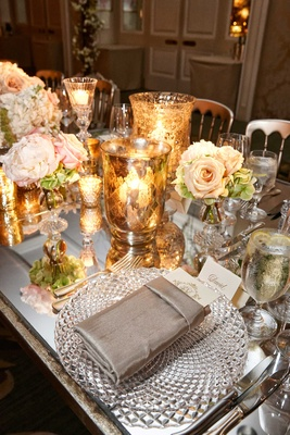 Wedding reception with mirror long table, white and pink flower centerpiece, gold vase with candles