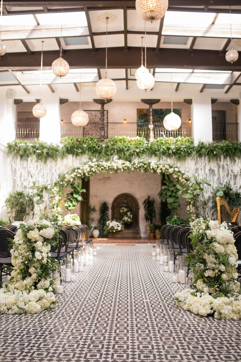 ebell long beach wedding ceremony with orchids and greenery from balcny