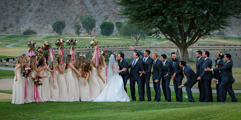 Fun bridesmaid and groomsmen photo with bouquets on golf course at la quinta resort and club