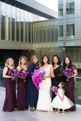 bride in cristiano lucci wedding dress, bridesmaids in plum dresses, mother of the bride, flower gir