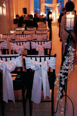 White bows around black ceremony chairs