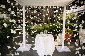 Orchid flowers on strings surrounding altar chuppah open sided ivory wedding ideas