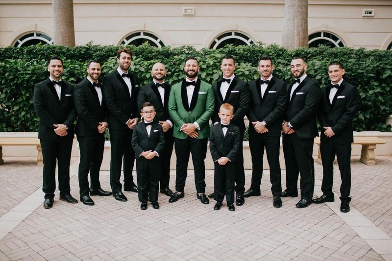groom in emerald green tuxedo jacket bow tie groomsmen in velvet tux and ring bearers