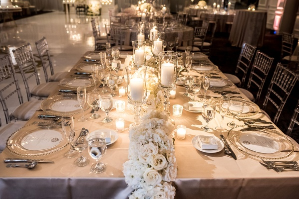 Long table with flower runner white roses and hydrangeas champagne linen candles