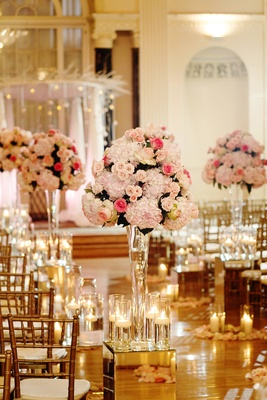 Mirror box with candles and pink flower arrangement at wedding ceremony