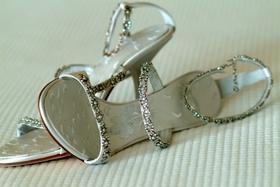Bride's silver wedding heels with sparkly straps