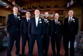 Men in tuxedos with rose boutonnieres