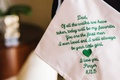 White handkerchief with green embroidery letter from bride to father of bride