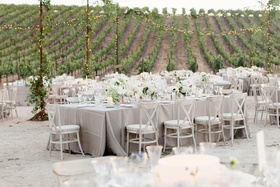 Outdoor vineyard wedding with grey linens and white flowers