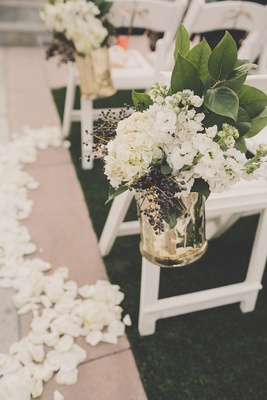 Aisle markers of white hydrangeas and berries