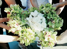 Bride's bouquet in middle of bridesmaid nosegays