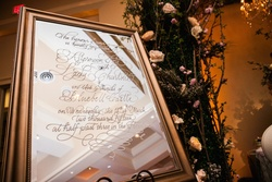 White calligraphy on framed mirror at inspirational styled shoot