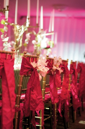 gold chairs wrapped with pink fabric