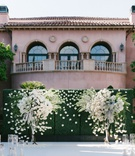 cheryl burke matthew lawrence wedding ceremony grand del mar mindy weiss white flowers green hedge