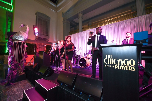 wedding band the chicago players gold coast events pink purple lighting live band peacock decor