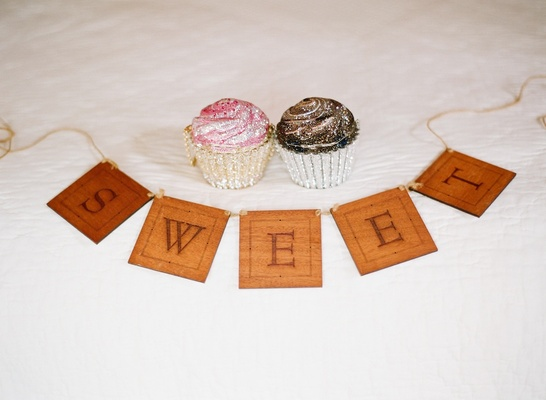 Sweet sign with bridal clutch in shape of cupcake
