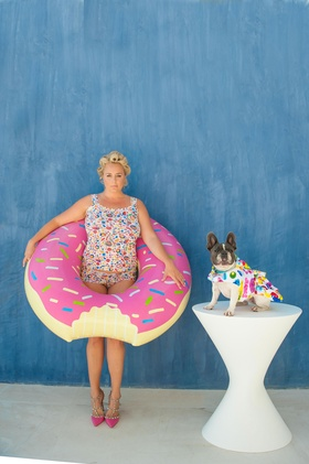bride with hair in curlers, multi-colored swimsuit, donut pool float, dog in swimsuit