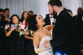 Wedding reception first dance bride with necklace and spaghetti strap dress for easy dancing updo