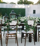 mr and mrs signs wooden chairs vines lanterns tables california outdoor reception beach