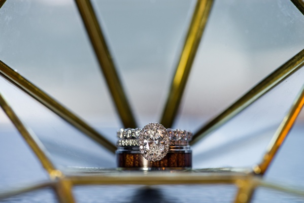 oval halo engagement ring and unique men's band