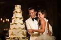 bride in ostrich feather skirt monique lhuillier groom white tuxedo white gold wedding cake regal
