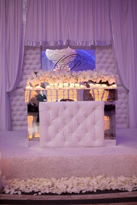 Wedding reception with fabric draped alcove for bride and groom
