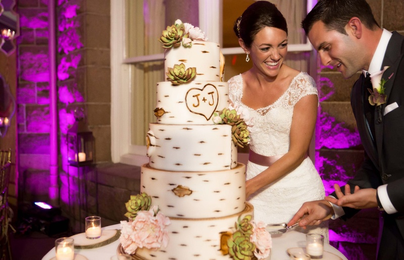 wedding cake made to look like a birch tree with the couples initials and sugar flowers - John Colaneri