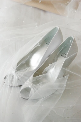 White Stuart Weitzman peep-toe pumps