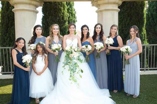 bride in vera wang ball gown, mismatched bridesmaids in blue shades, junior bridesmaid, flower girl