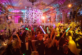 Guests on dance floor at wedding reception The Plaza Hotel in New York City glow sticks and lighting